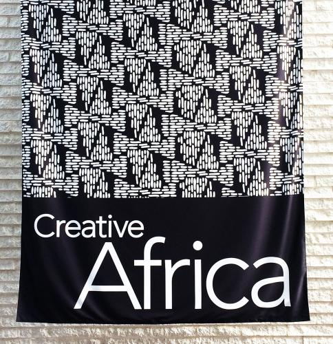 The entrance banner in the atrium of the Perelman Building at the Philadelphia Museum of Art. The black and white triangular motif announces the importance of geometric patterning in the arts of Africa.